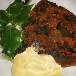 Dishy Gluten Free Plum Pudding a la Sir Charles, served with Honey Brandy Butter & holly fresh from our Hoxton Garden