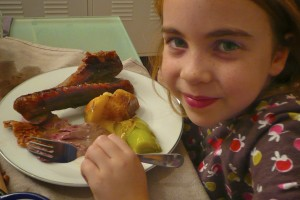 Elodie about to enjoy a giant goose wing.